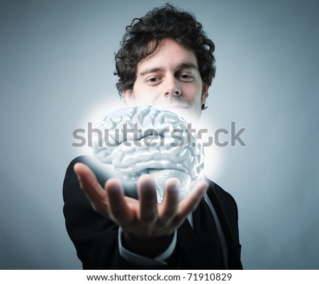 young businessman hold 3d brain selective focus image