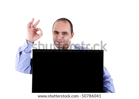 Young businessman holding a blackboard displaying the sign of success, isolated on white background - stock photo