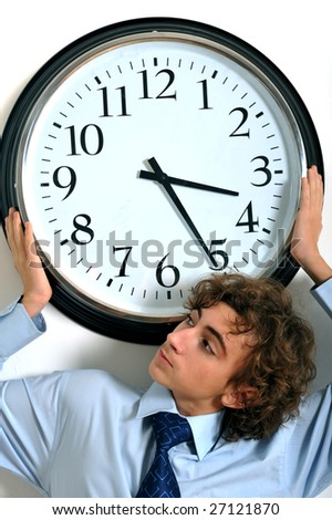 Young businessman holding a clock, deadline concept - stock photo