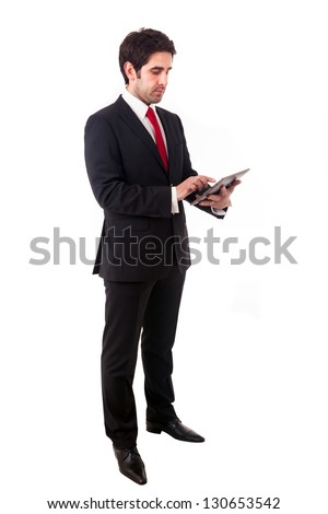 Young businessman holding a digital tablet, isolated on white background