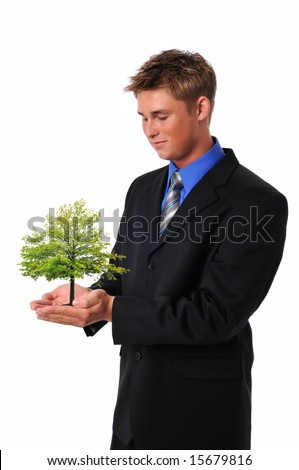 Young businessman holding a tree with care isolated on white - stock photo