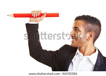 Young businessman holding an oversized red pencil