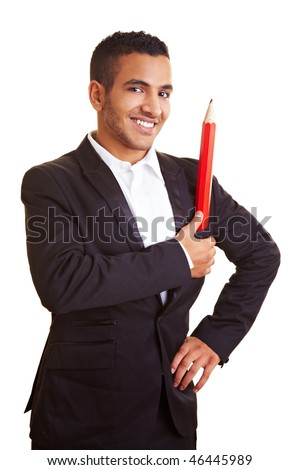 Young businessman holding an oversized red pencil - stock photo