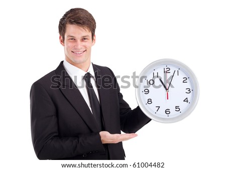 young businessman holding clock over white - stock photo