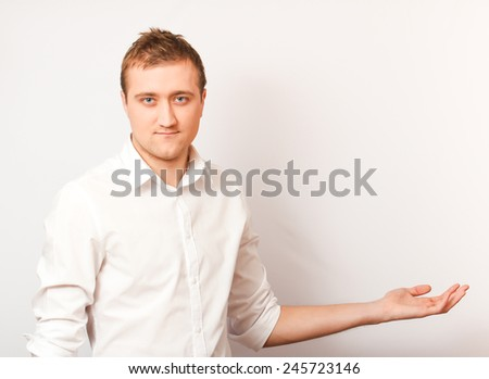 Young  businessman holding copyspace.