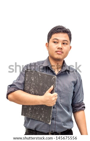 Young businessman holding grey file folder