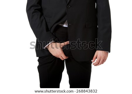 Young businessman holding his crotch because of pain. - stock photo