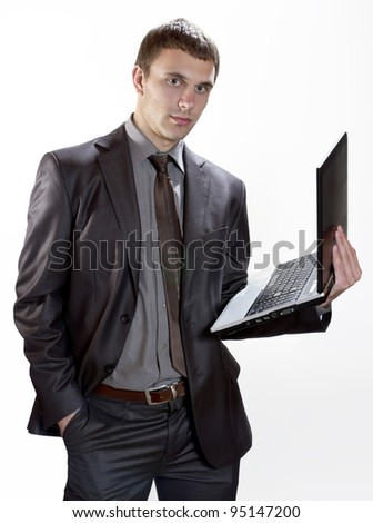Young Businessman holding laptop - stock photo