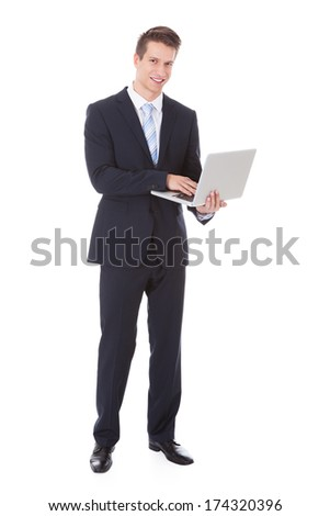 Young Businessman Holding Laptop Over White Background - stock photo