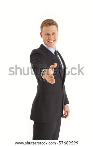 Young businessman holding out hand to shake - stock photo