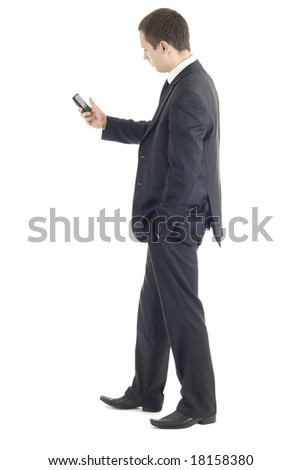 Young businessman holding phone