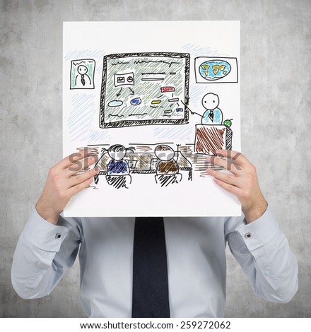 young businessman holding poster with drawing education in academy - stock photo