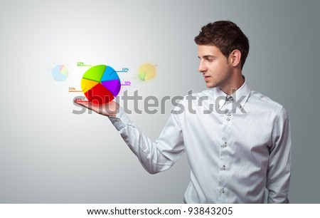 Young businessman holding virtual business sign - stock photo