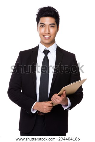 Young businessman holding with file board