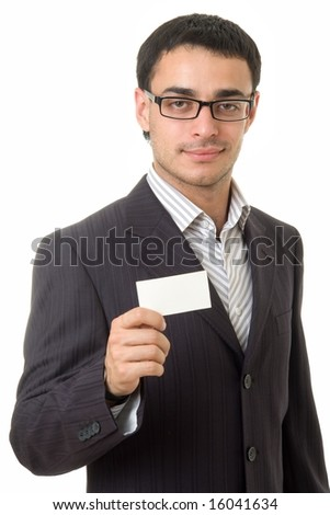 Young businessman holds an empty business card, isolated on white background. - stock photo