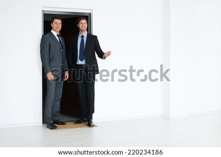 Young businessman in a suit indoors - stock photo