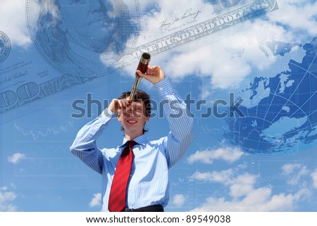 young businessman in a suit with a golden cup against blue sky