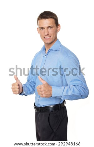 Young businessman in blue shirt shows you thumbs up - stock photo