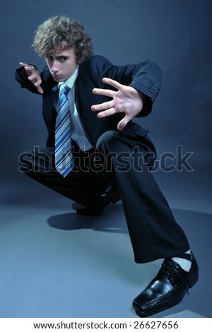 Young businessman in martial art position - stock photo