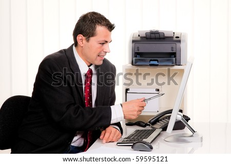 Young businessman in office with computer