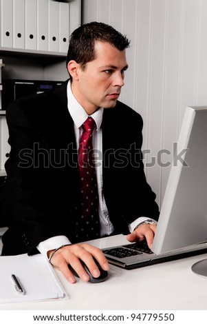 young businessman in office with computer desk - stock photo