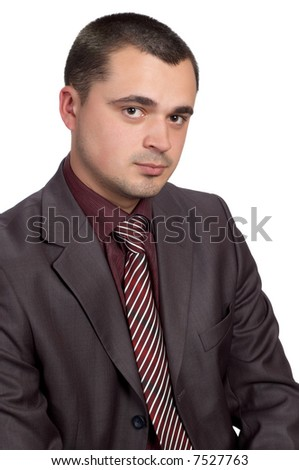 young businessman in shimmering suit and red shirt