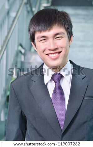young businessman in success face - stock photo