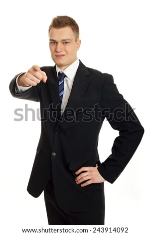Young businessman in suit shows on you