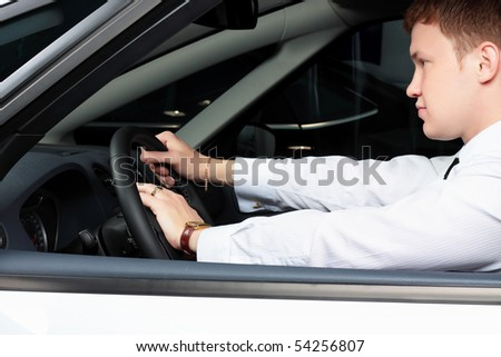 young businessman in the car