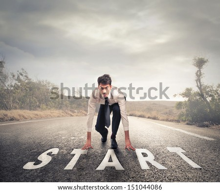 young businessman in the starting position - stock photo