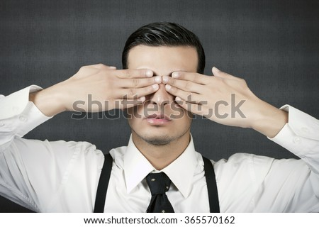 Young businessman is making See no Evil, Hear no Evil, Speak no Evil gesture. - stock photo