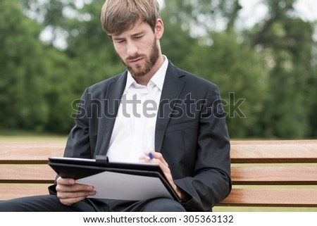 Young businessman is taking care of paper work