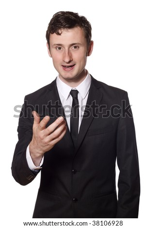 young businessman is talking and adressing the viewer of this picture - stock photo