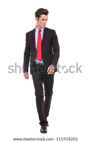 young businessman is walking. He is smiling and looking away from the camera to his left side. isolated over white background