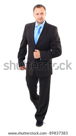 young businessman is walking. He is smiling and looking to the camera. isolated over white background - stock photo