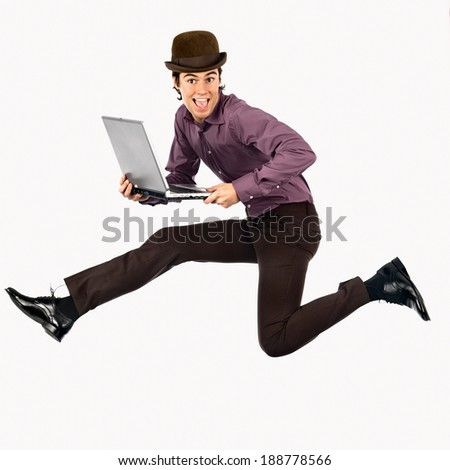 Young businessman jumping.