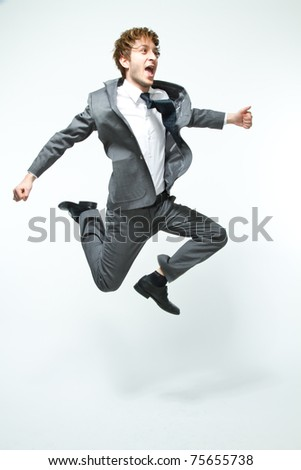 young businessman jumping - stock photo