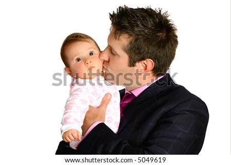 Young businessman kissing his adorable baby girl, isolated. - stock photo