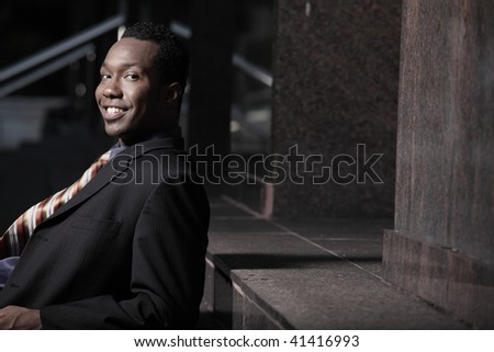 Young businessman laying back and relaxing - stock photo