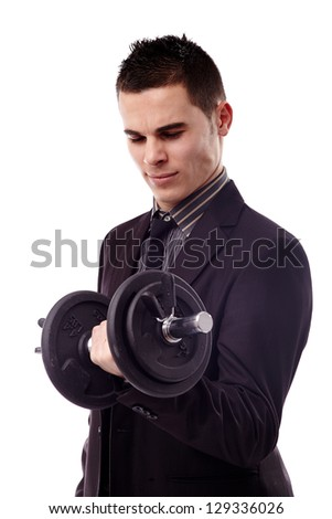 young businessman lifting a dumbbell over white background in closeup pose - stock photo