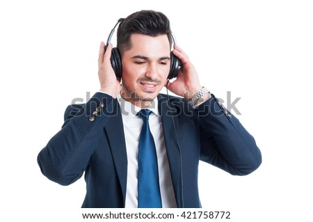 Young businessman listening music on headphones looking happy as relaxation and leisure concept isolated on white