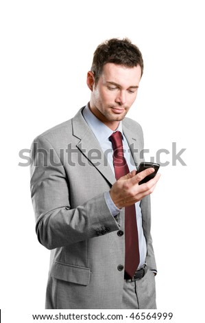 Young businessman looking at his pda mobile phone isolated on white background - stock photo