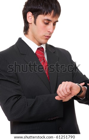 young businessman looking at watch over white background - stock photo