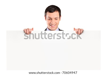 Young businessman looking at white banner isolated on white background - stock photo