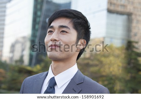 Young businessman looking away - stock photo
