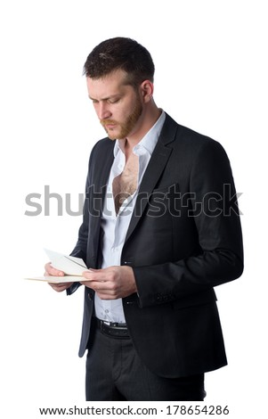 young businessman looking sad at pictures, isolated on a white background
