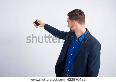 young businessman making selfie
