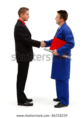 Young businessman meeting engineer and shaking hands - stock photo