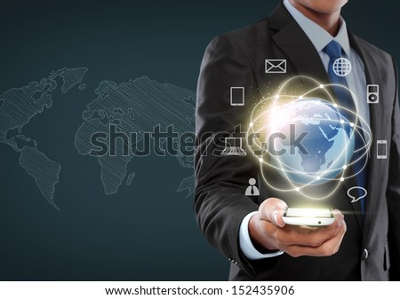 Young businessman navigating in virtual reality interface - stock photo