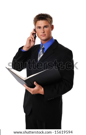 Young businessman on a cell phone isolated on a white background